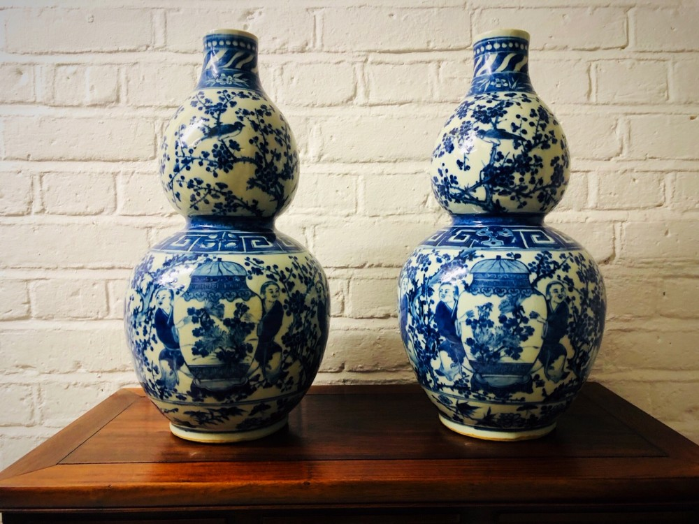 a pair an antique 19th century chinese double gourd blue and white vases