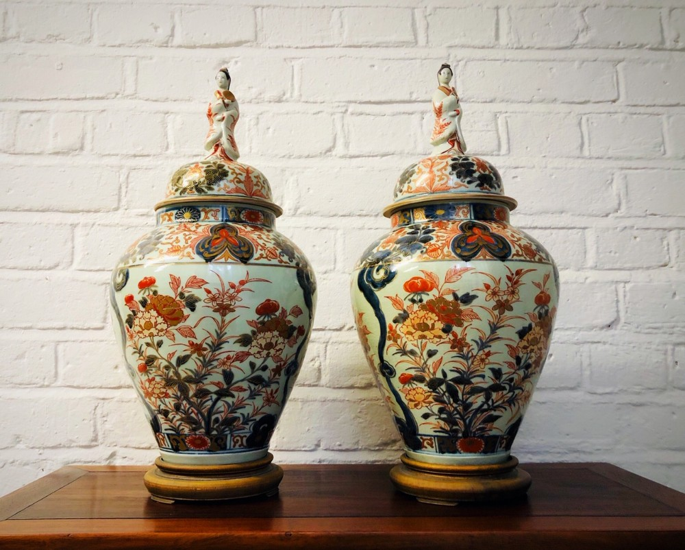 a decorative pair of antique japanese jars and covers