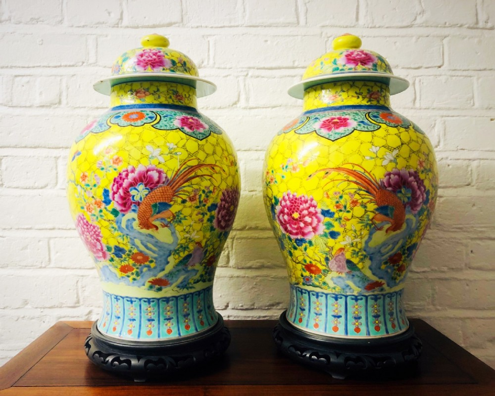 a pair of spectacular antique famille rose large jars and lids