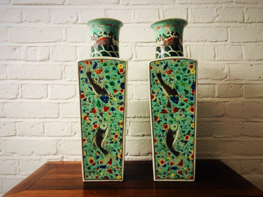 a perfect pair of 19th century kang hsi style famille verte vases