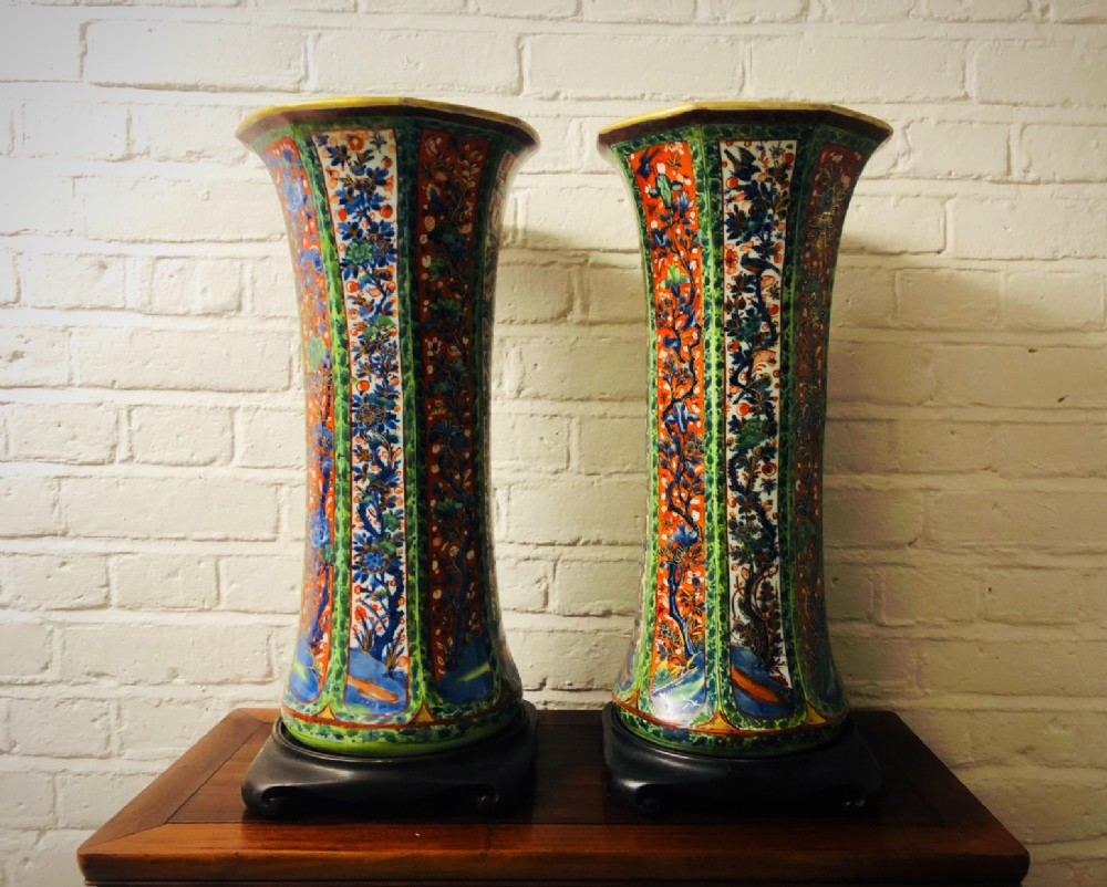an imposing pair of antique kang hsi clobbered ware flared top vases