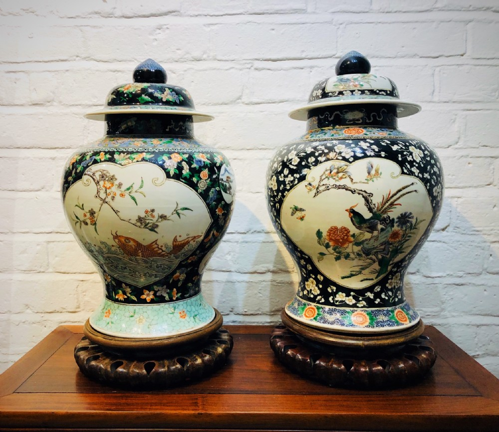 a matched pair of antique chinese jars and covers
