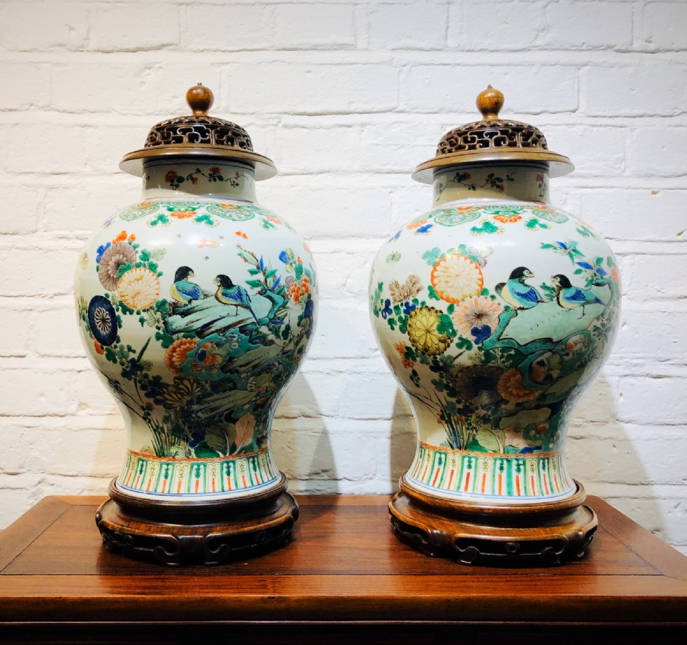 a pair of antique chinese vases with stands and covers