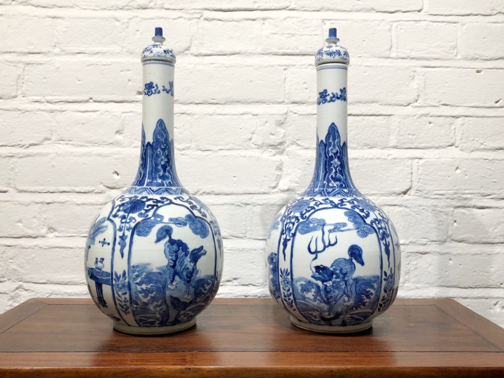 a mint condition pair of late 19th century blue and white bottle vases and covers