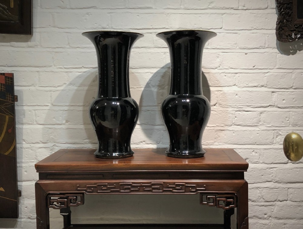 a pair of tall black antique chinese gushaped vases late 18th century early 19th century