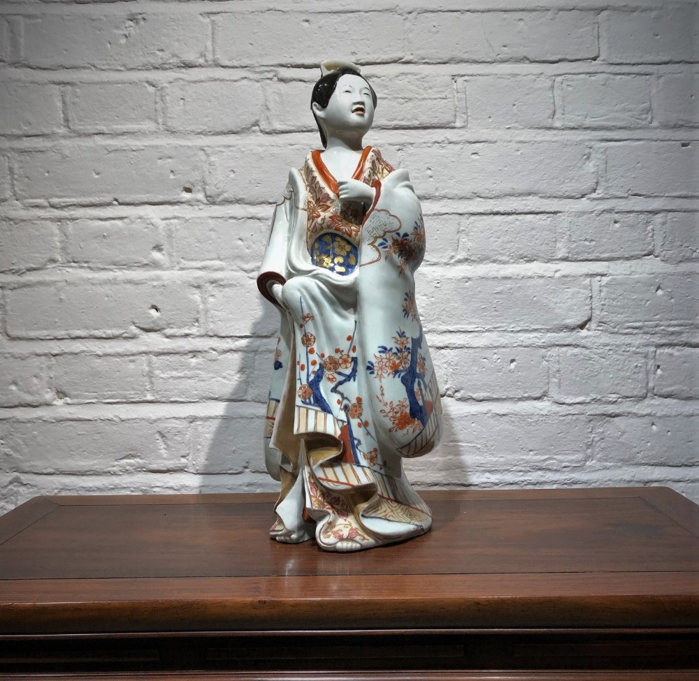 a pretty japanese imari bijin figure from the late 17th century