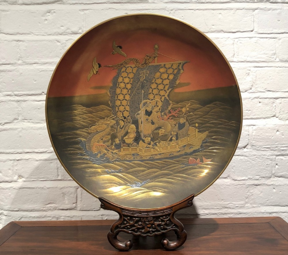 a wonderful lacquer dish depicting the seven lucky gods aboard their treasure ship