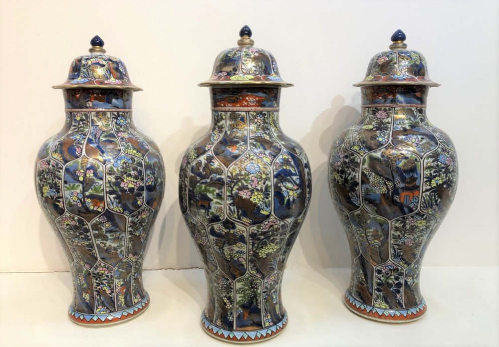a matched trio of antique chinese cobbled kang hsi jars and covers
