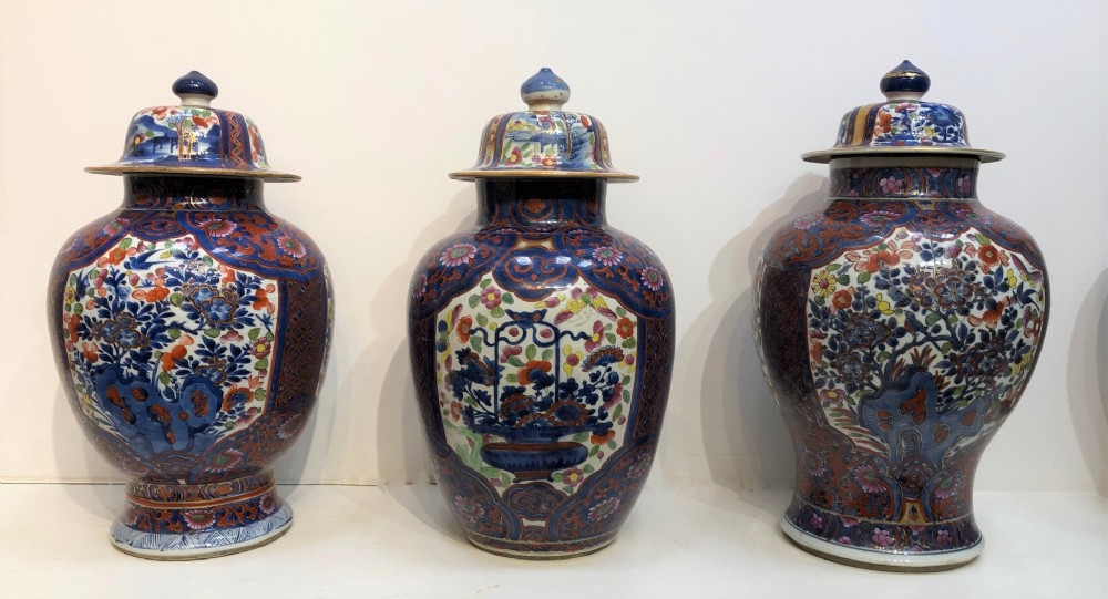 three matched cobbled antique chinese jars and covers
