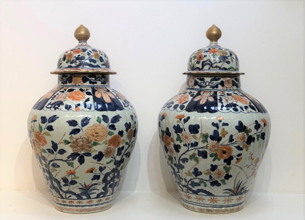 a pair of large antique japanese imari jars and covers