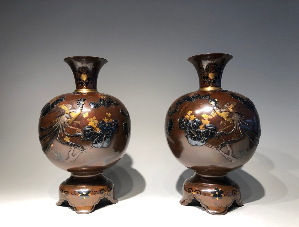 a stunning pair of japanese meiji period bronze vases