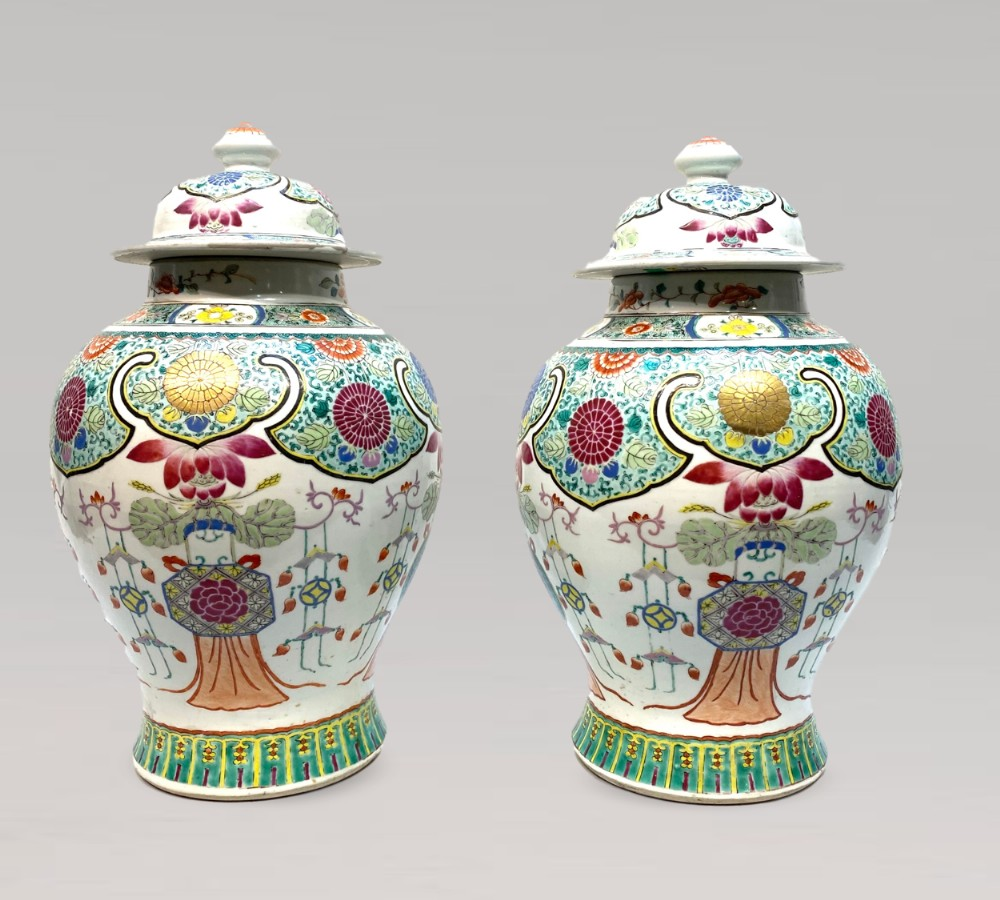 a colourful pair of antique chinese famille rose jars and covers c 1850