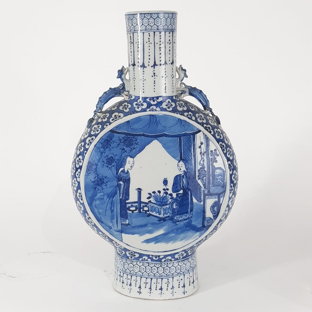 a chinese blue and white moonflask with decoration of ladies
