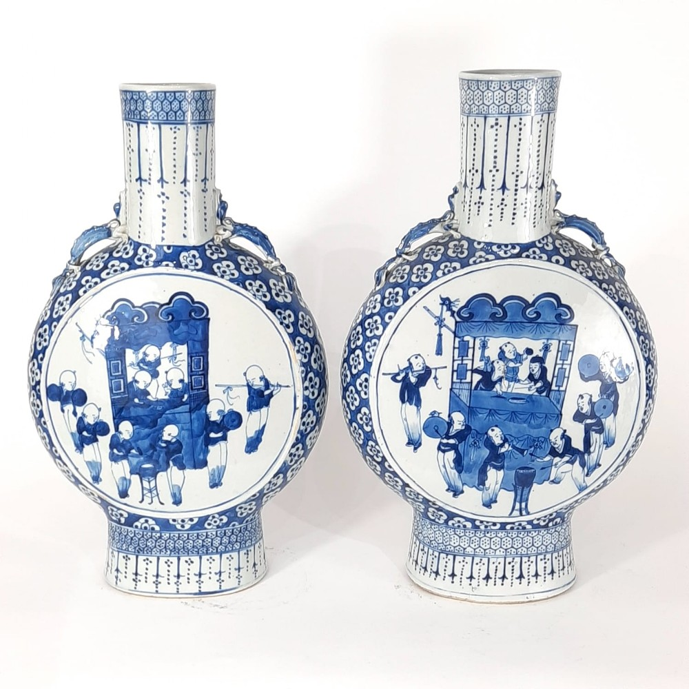 a pair of chinese blue and white moonflasks