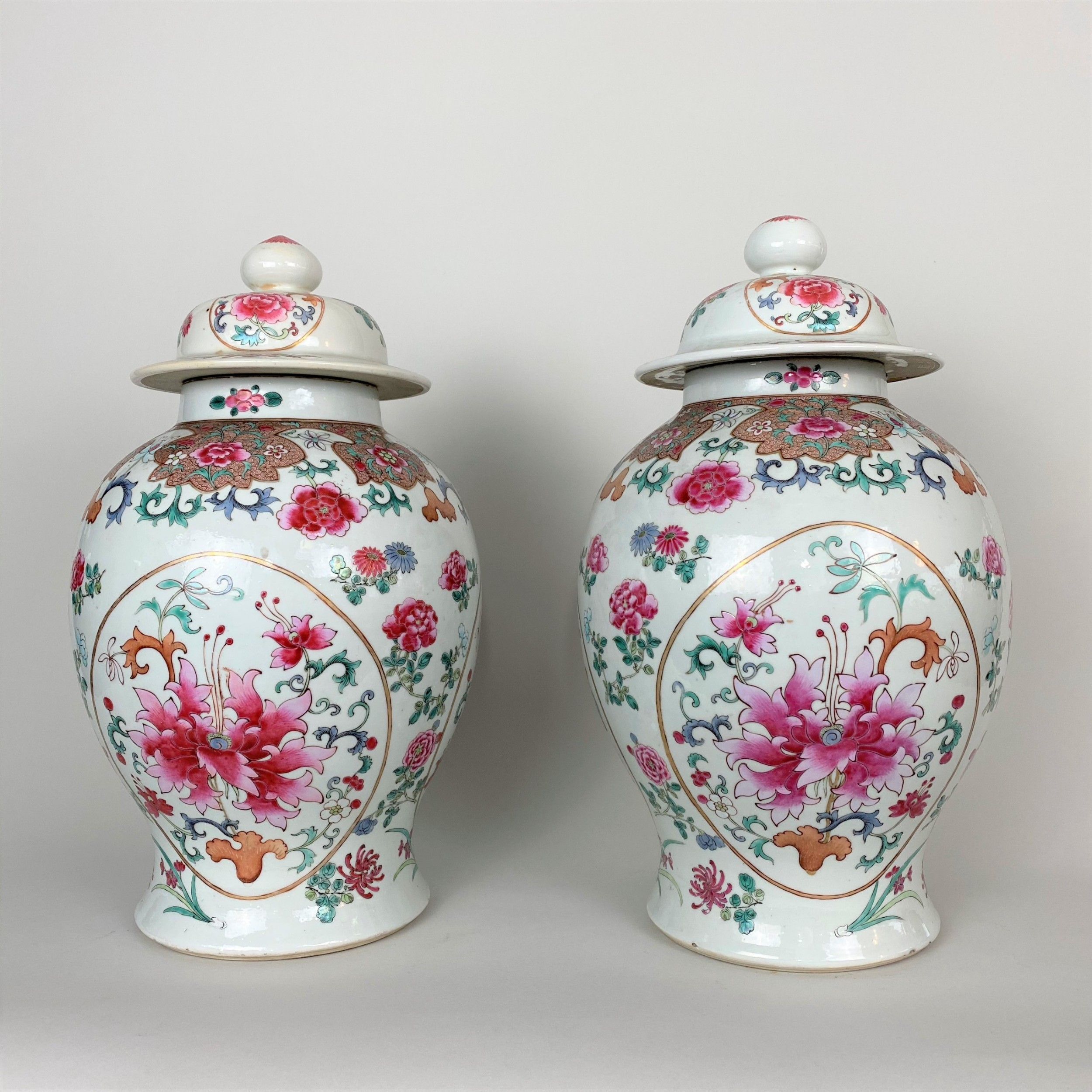 a decorative pair of large 19th century jars and covers
