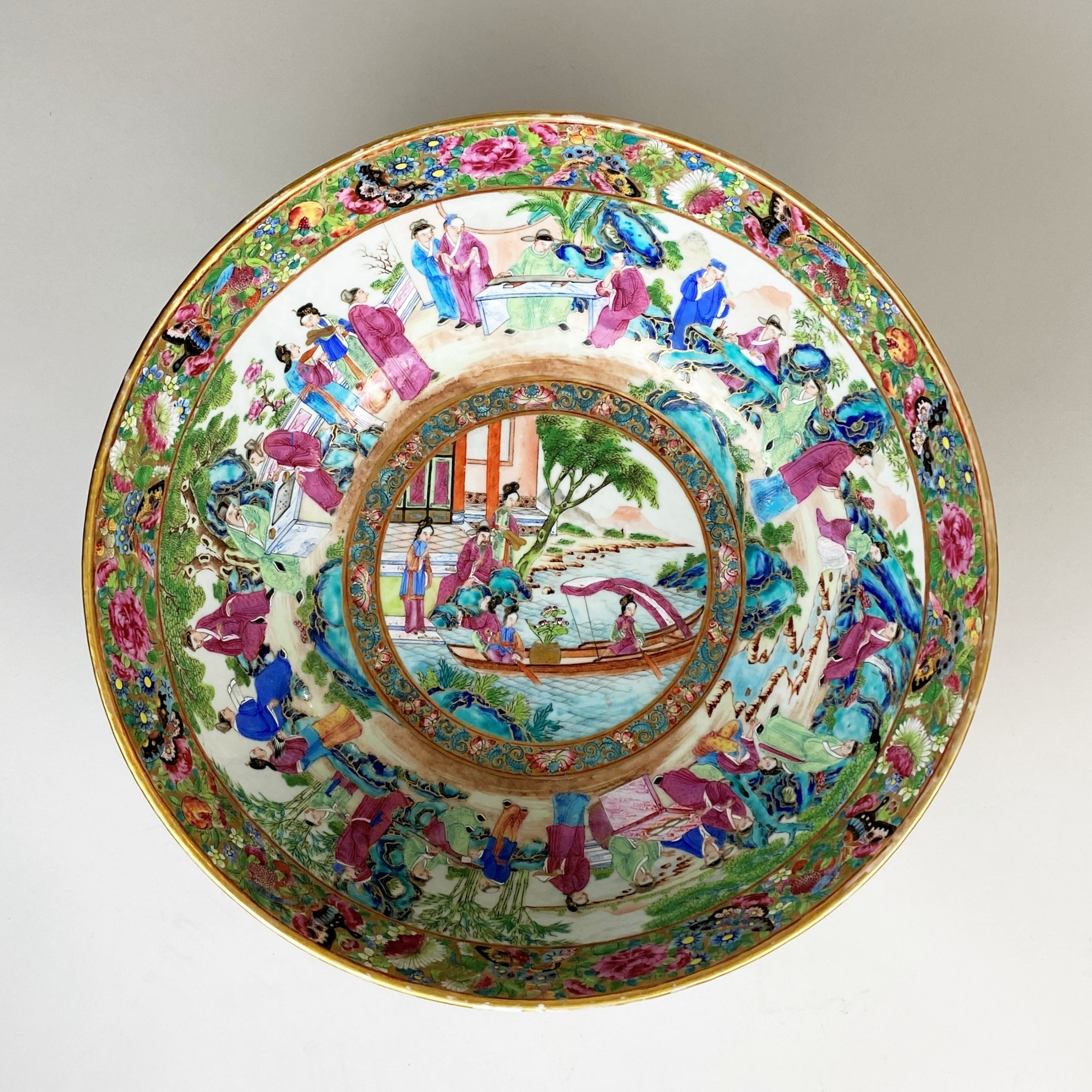 a decorative early 19th century canton punch bowl and stand