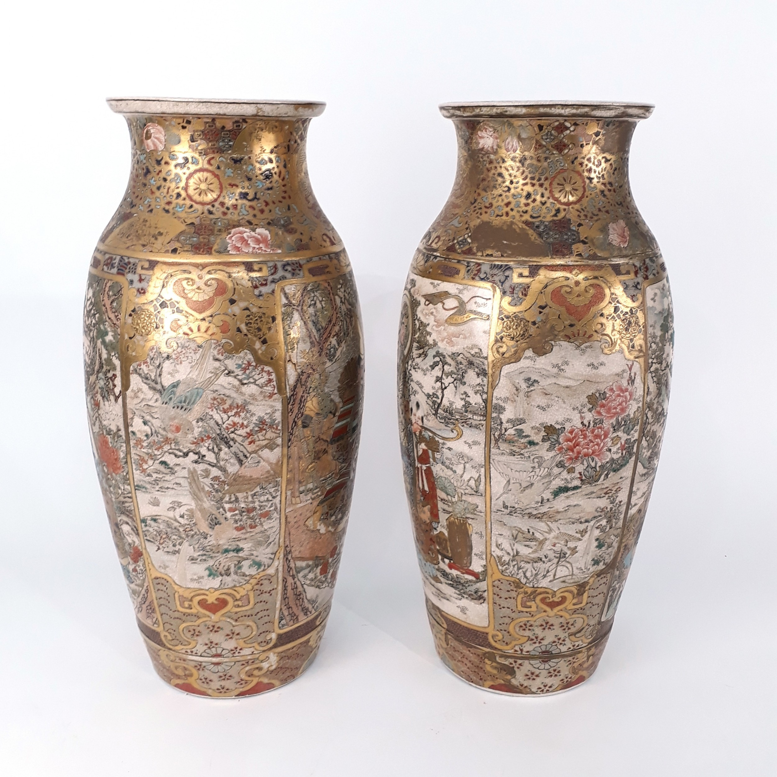 a pair of japanese satsuma vases with decoration of samurai and deities