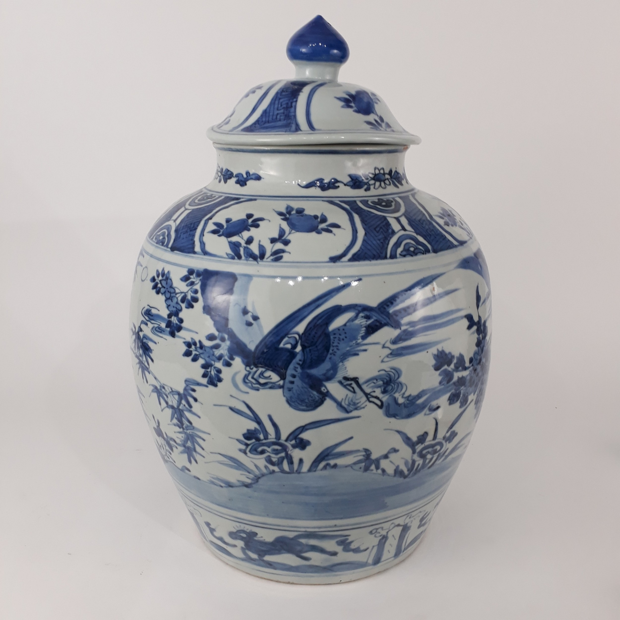 a chinese blue and white ming jar and cover