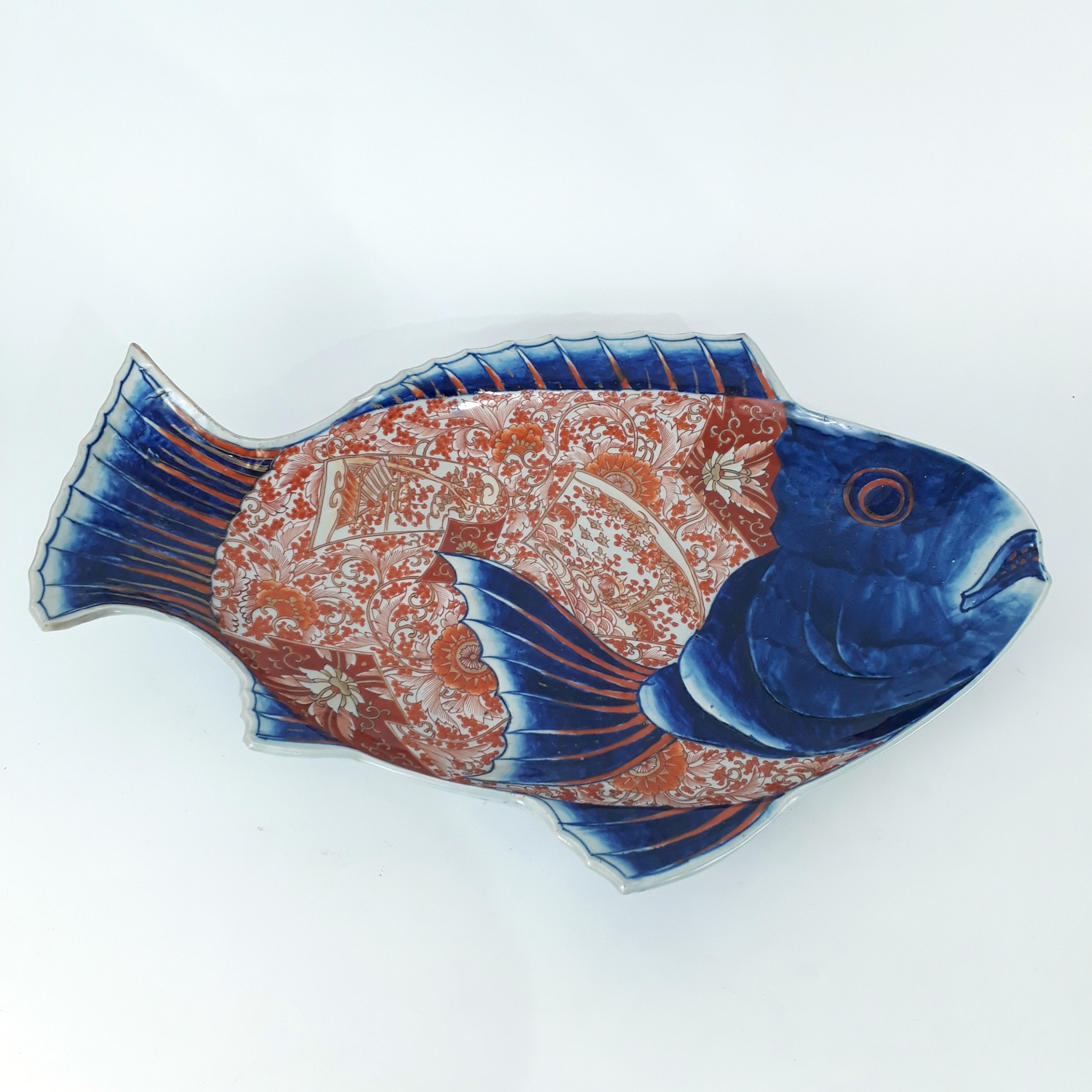 a japanese imari plate in the form of a fish