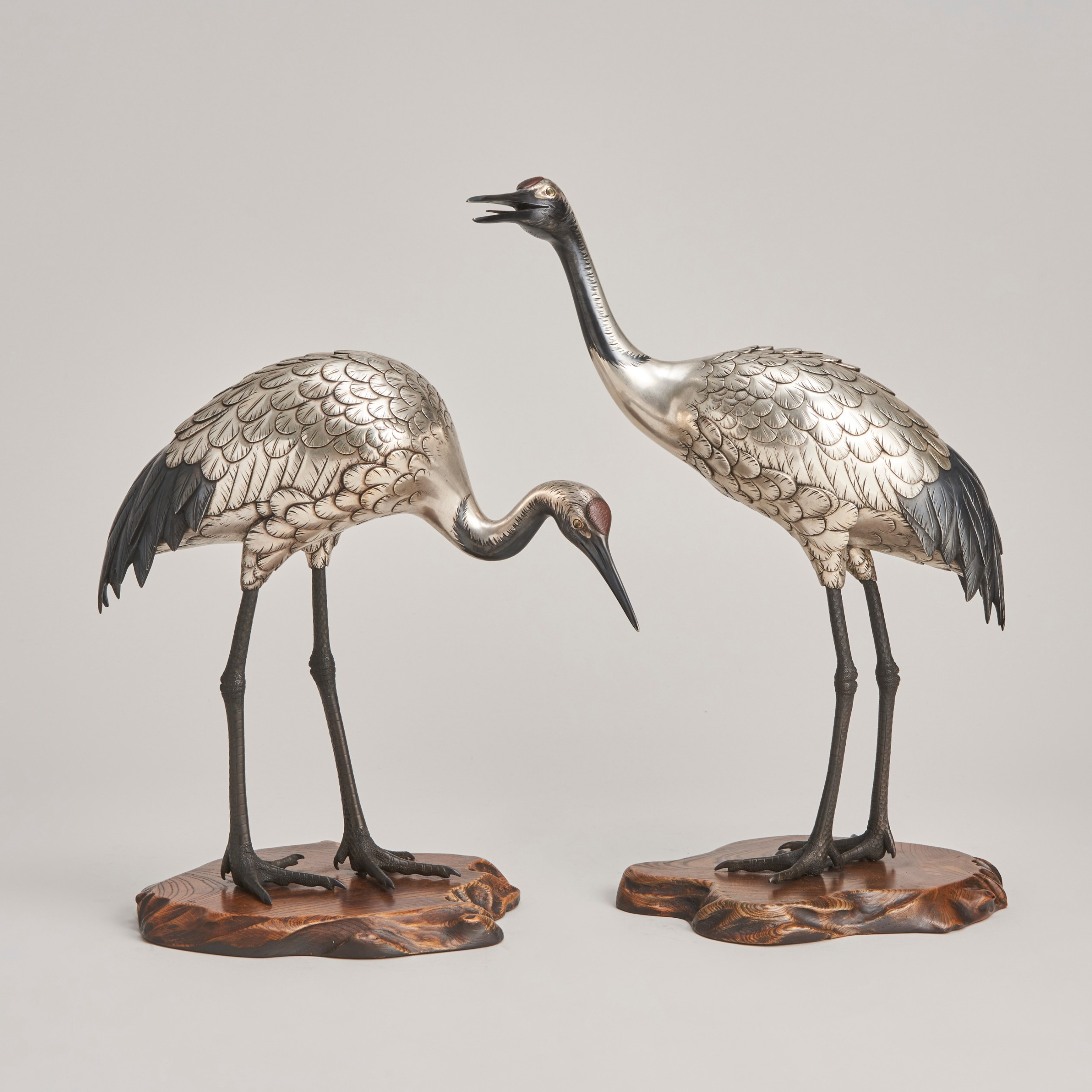 a beautiful silvered bronze pair of red crowned cranes japanese late 19th century