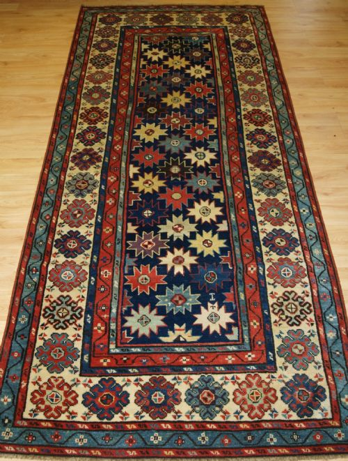 Thumbnail picture of: ANTIQUE CAUCASIAN TALISH LONG RUG WITH STAR DESIGN, SUPERB COLOURS, MID 19TH CENTURY.