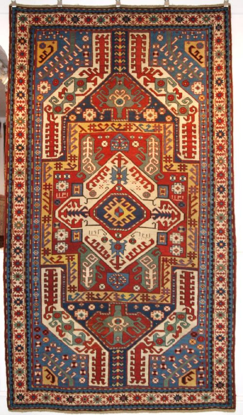 Thumbnail picture of: ANTIQUE CAUCASIAN KASIM-USAG RUG, CLASSIC DESIGN WITH SUPERB COLOUR, DATED, 1893.