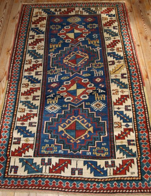 antique caucasian kazak rug bold design with animals late 19th century