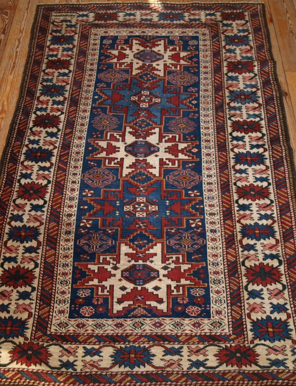 antique caucasian rug with lesghi star design dated 1325 circa 1900