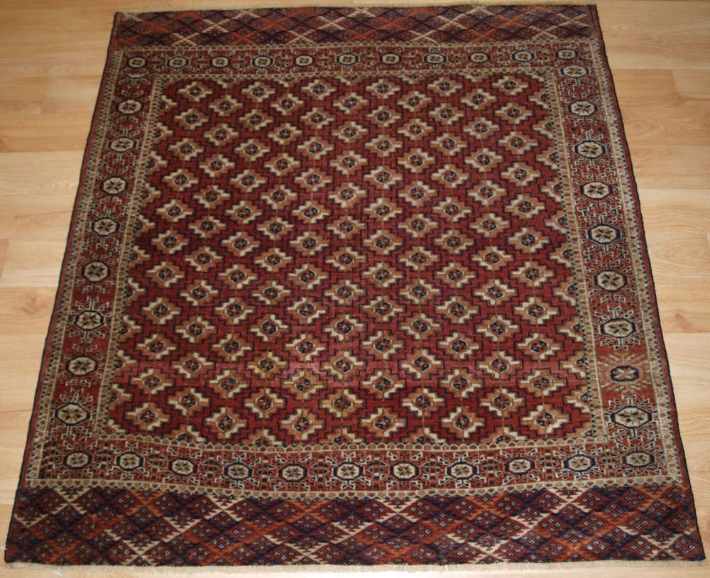 antique tekke turkmen small square dowry rug with chuval guls circa 1900