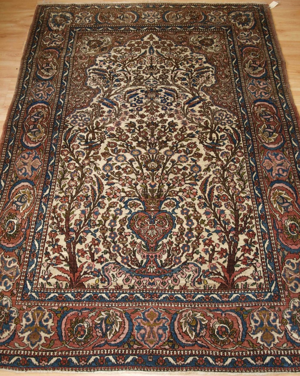 antique isfahan prayer rug of floral vase design one of a pair 1 circa 1900
