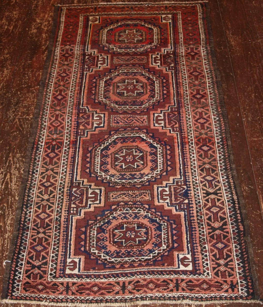 antique baluch rug with star gul design afghanistan circa 1900