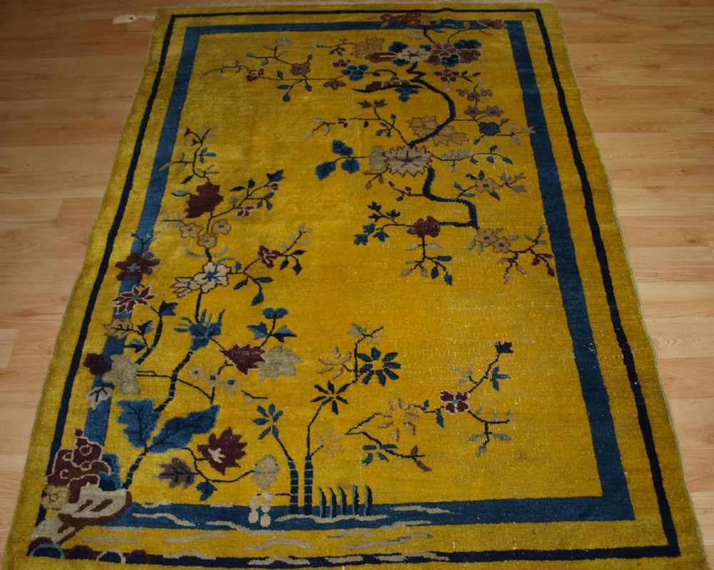 antique yellow ground chinese peking rug traditional design circa 1900