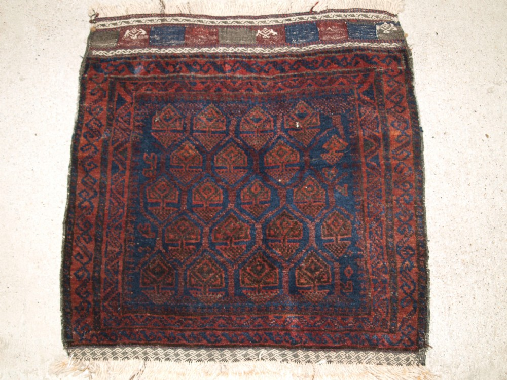 antique timuri baluch bag face with traditional design closing panel at top circa 1920