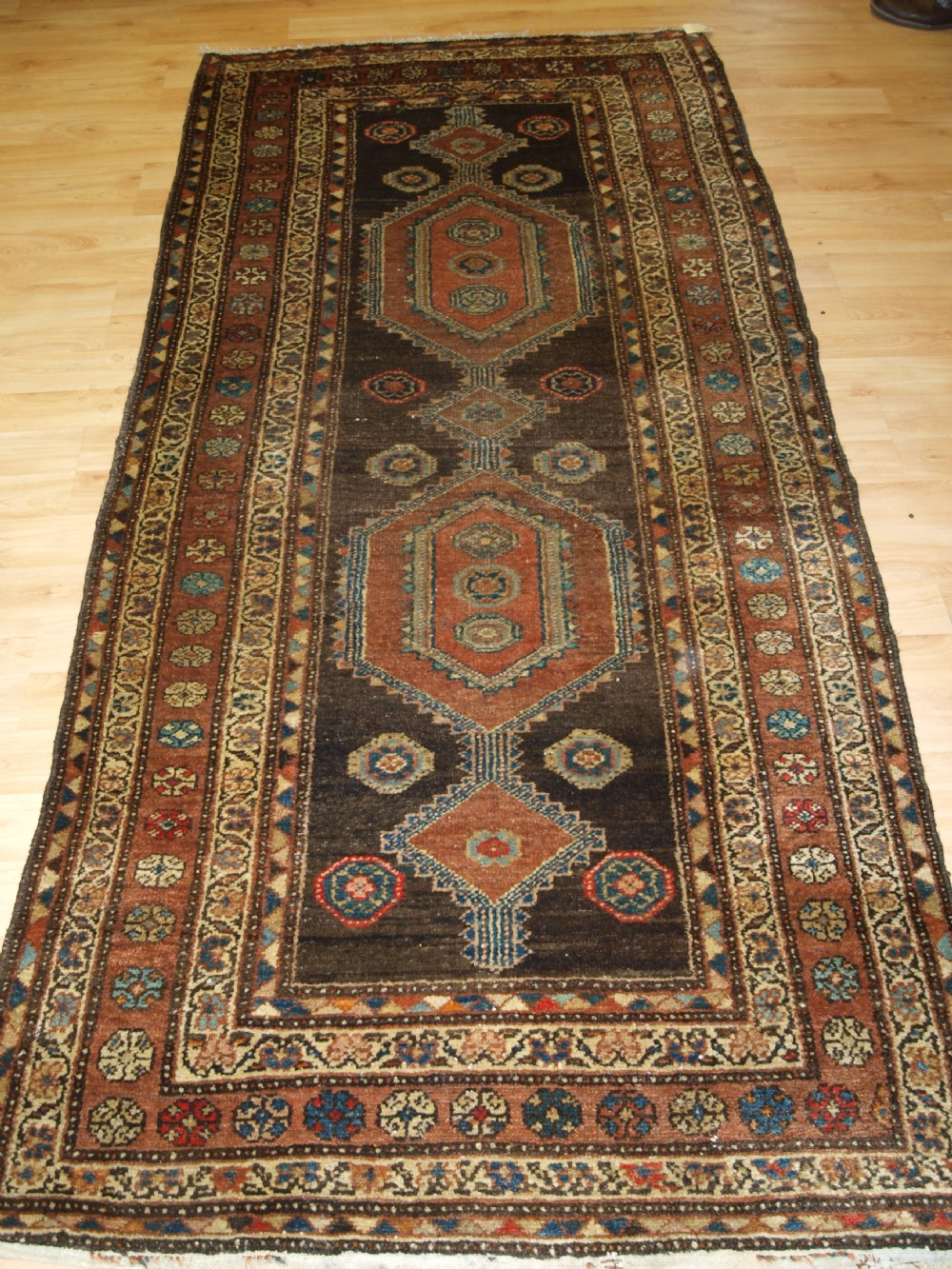 antique kurdish long rug linked medallion design circa 1900