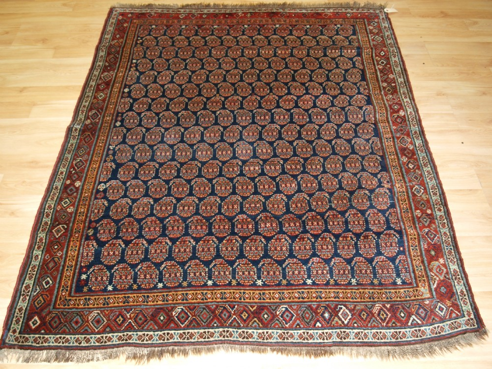 antique north west persian kurdish rug with all over boteh design circa 190020