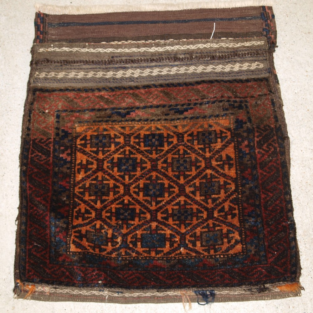 antique baluch saddle bag with plain weave back lattice design circa 1900