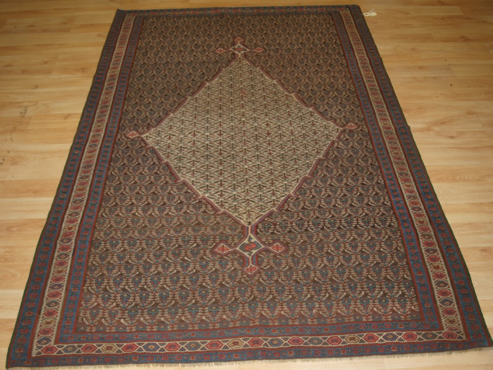 antique senneh kilim traditional boted design with medallion circa 1900
