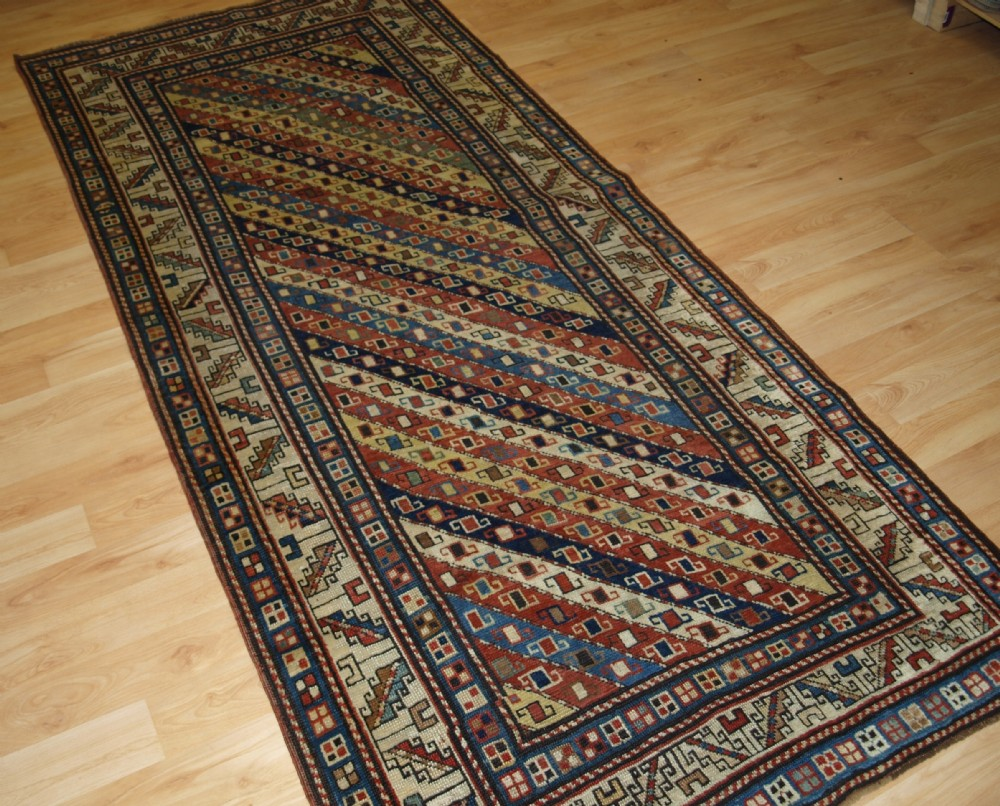 antique caucasian gendje kazak long rug with stripe design superb colours 2nd half 19th century