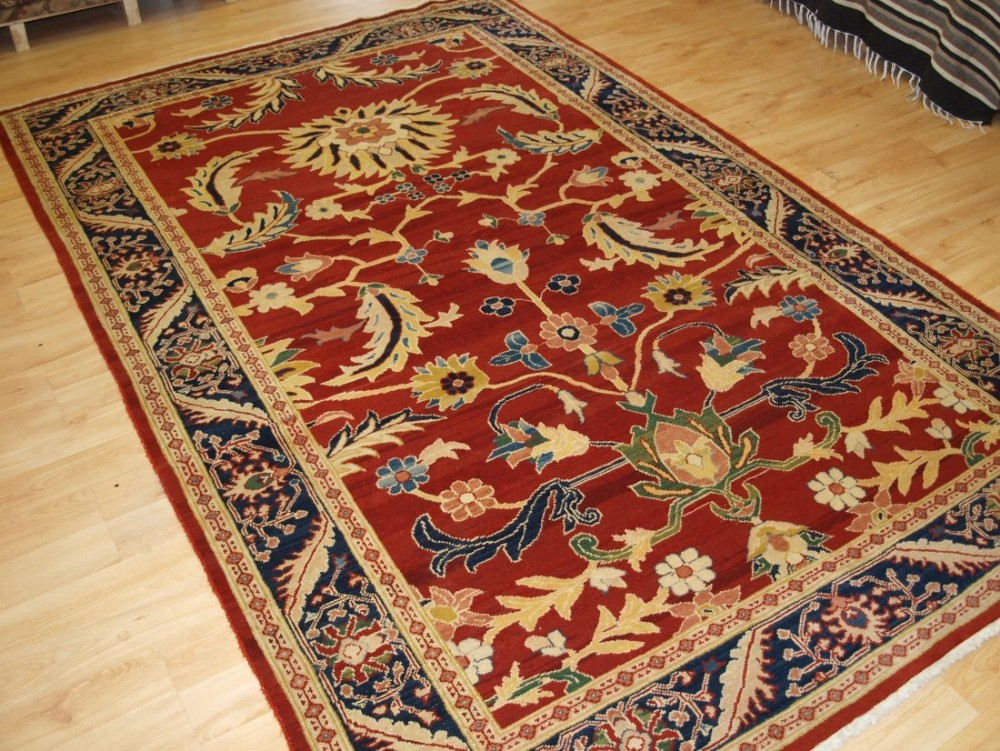 old ziegler style rug bold design on a red ground 20 years old