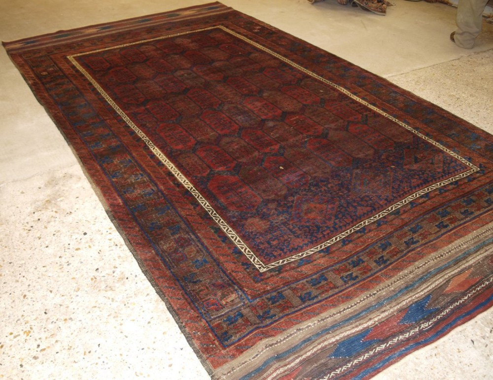 antique western afghan baluch carpet shrub design long kilim ends circa 1870