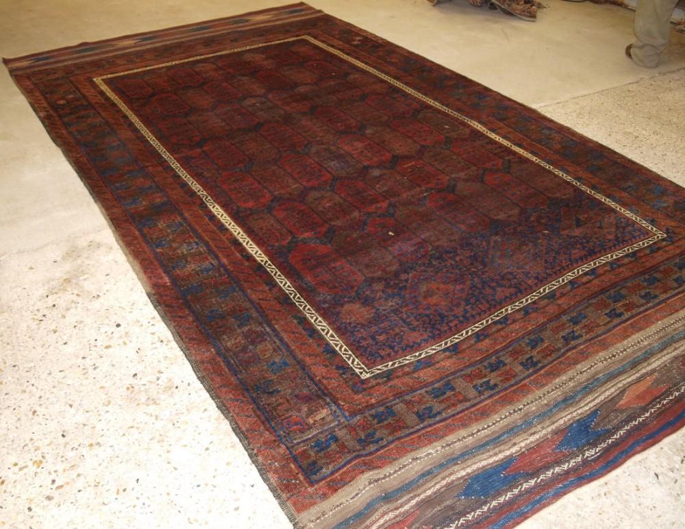 antique western afghan baluch carpet shrub design long kilim ends circa 1870