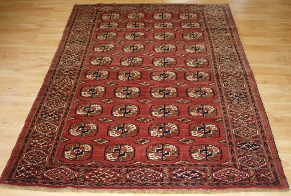 old tekke turkmen rug with soft faded red colour good furnishing rug circa 1920