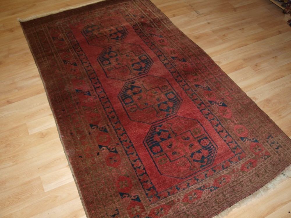 old afghan village rug of traditional design soft rose red colour circa 1920