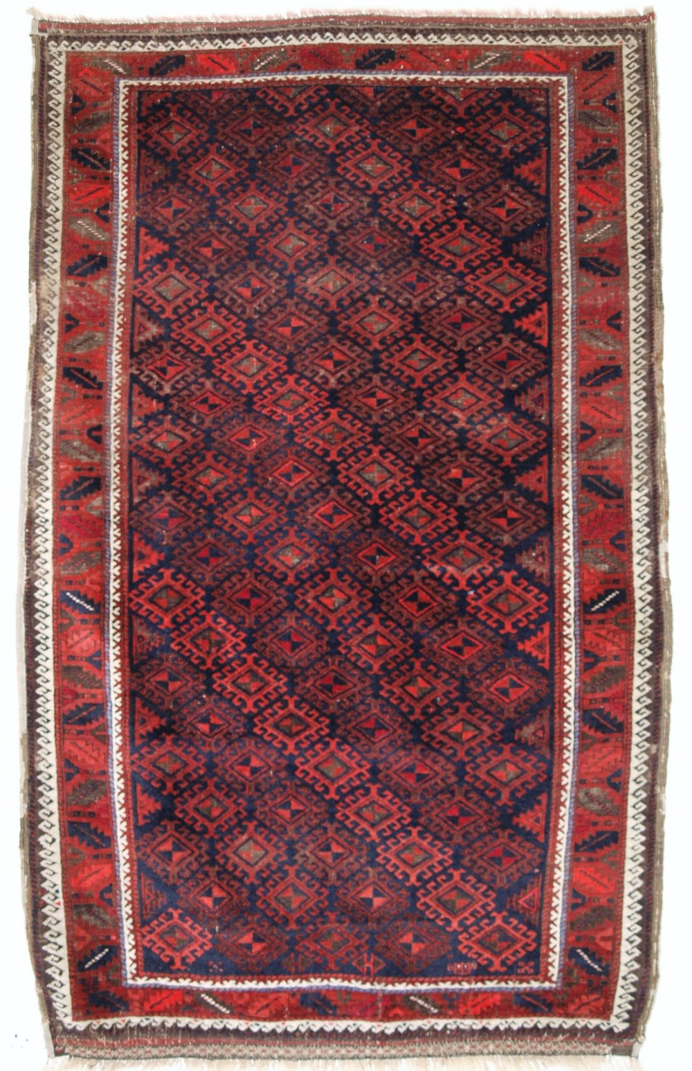 antique baluch rug of larger than normal size latch hook medallion lattice design circa 1880