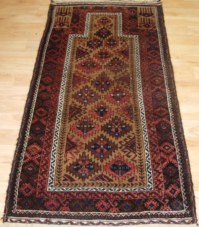 antique baluch prayer rug camel ground with interesting design circa 1900