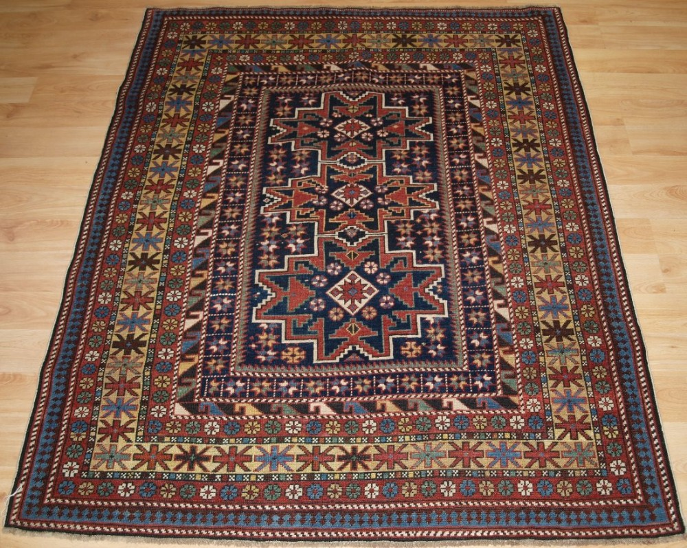 antique caucasian rug with 'leshgi star' design outstanding small rug late 19th century