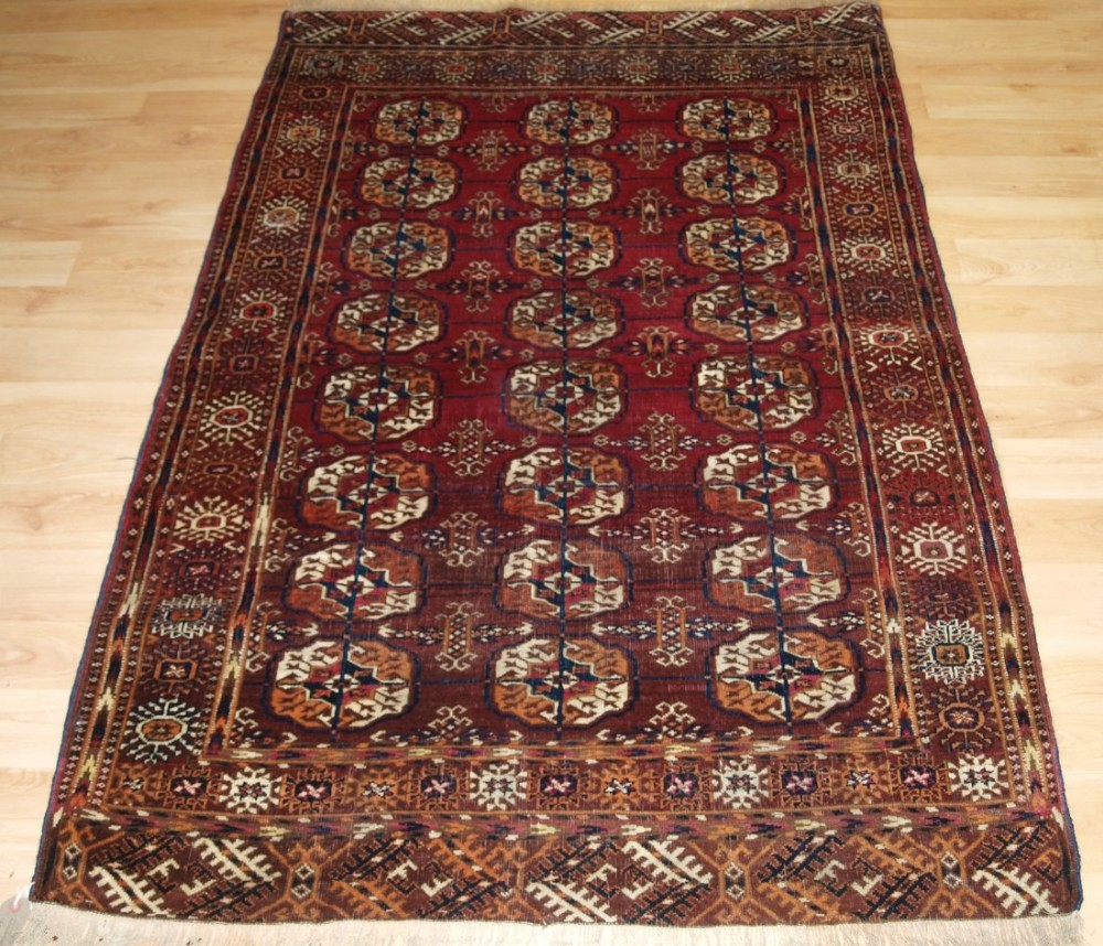 antique tekke turkmen 'dip khali' rug deep crimson red colour small size circa 1900