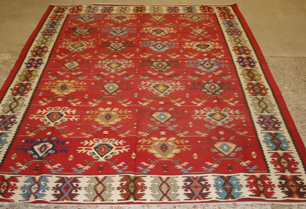 old turkish sarkoy kilim rug unusual design on soft red ground circa 1920