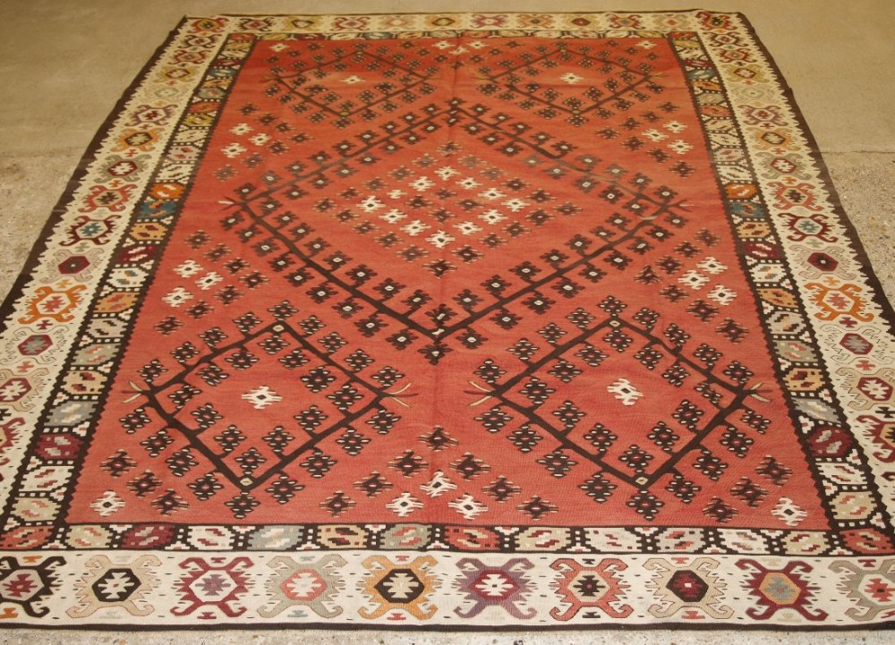 old turkish sarkoy kilim rug traditional design on soft red ground circa 1920