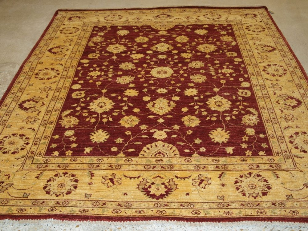 afghan ziegler design rug burgundy field with ivory gold border about 10 years old